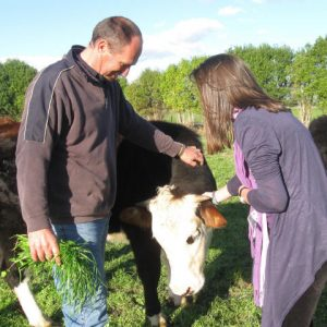 Andre and daughter Sarah at home with Buddy the cow